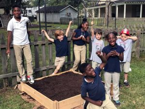 A local mission in Denham Springs, the kids of the LANDers plant a garden in the after school program.