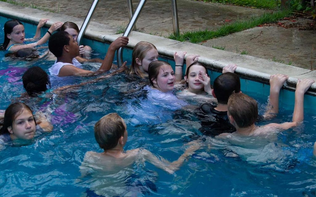 Luke 10:27 kids participating in our Youth Ministry and hanging out at the pool in Denham Springs