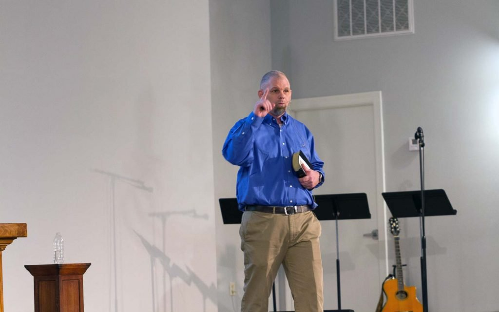 Lonnie Shupe delivers the  sermon during a Sunday worship service  at Luke 10:27